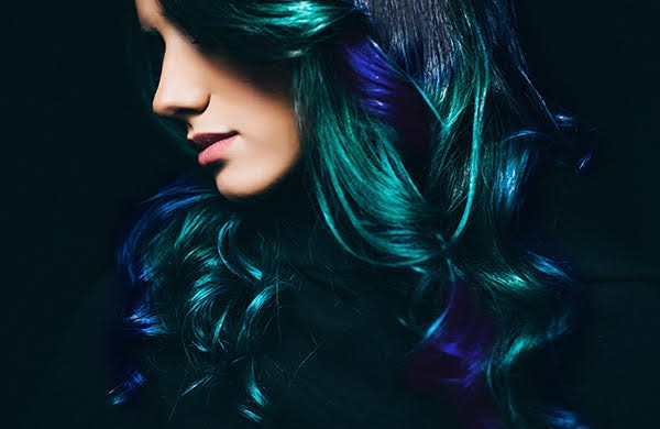 Subtle Peacock Highlights On Black Wavy Hair